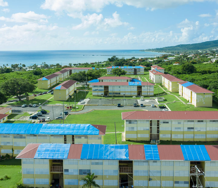 Federal funding has been appropriated to help repair public housing such as the Walter I.M. Hodge public housing neighborhood on St. Croix, which still shows extensive damage two years after the hurricanes of 2017. (Aerial photo by Daryl Wade)