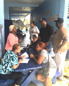 Volunteers take information from shelter applicants on Sept. 8, 2017, at the Sprauve School. (Source photo by Amy Roberts)
