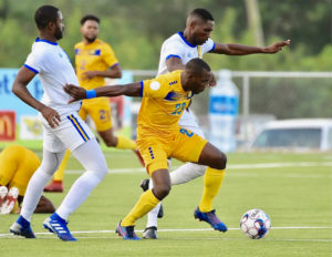Rashad Jules of Barbados fights off two USVI defenders en route to scoring the only goal in Saturday's CONCACAF match. (CONCACAF photo)