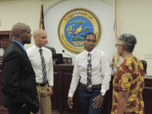 The three nominees for the Cannabis Advisory Board talk with Sen. Janelle Sarauw during the Rules and Judiciary meeting Friday. From left, Miguel Tricoche, Hugo Roller II, Catherine Keen. (Photo by Barry Leerdam for the USVI Legislature)