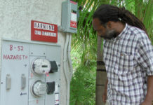 Energy Office technician Carl Joseph inspects a net metering site in 2010 on St. Thomas in the territory's previous program. (Source file photo by Don Buchanan)