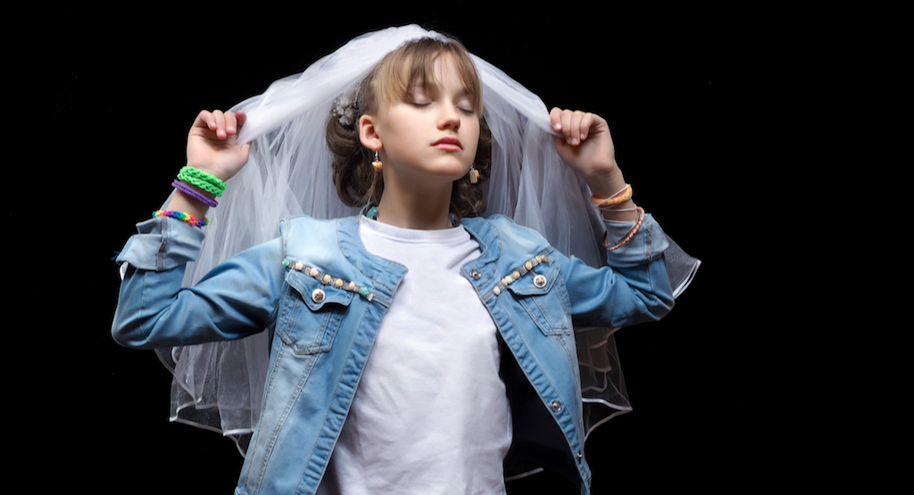 According to the World Bank, 41,000 girls younger than 18 get married every day. (Child wedding image from Shutterstock)
