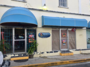 Molly Buckley of St. Croix Underwater Bluewater Adventures in downtown Christiansted is one of several business owners who said power flucations have damaged equipment. (Source photo by Susan Ellis)