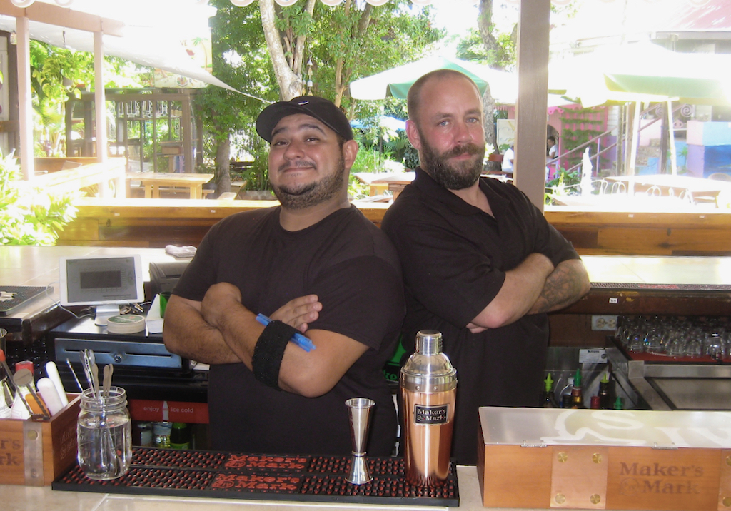 Proprietors Brandon Lutzy and Brian Cox man the bar at their new eatery, Whiskey Business. (Source photo by Teddi Davis)