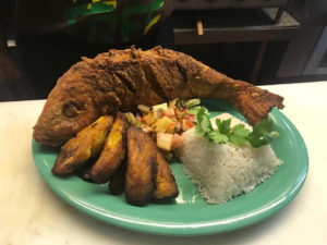 Whiskey Business offers blackboard specials that change nightly such as whole snapper with pineapple salsa. (Source photo by Teddi Davis)