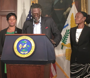 Agriculture commissioner Positive T.A. Nelson introduces Deputy Commissioner Khadija Blyden, left, and Assistant Commissioner Dianna Callwood. (Source photo by Susan Ellis)