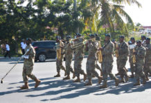 The USVI 73rd Army Band leads the procession down Veterans Drive in St. Thomas. (Source photo by Bethaney Lee)
