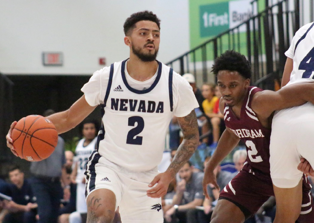 Jalen Harris, who was the player of the game in Nevada's opening day victory, dribbles past a Fordham defender who struggles to get through a pick. (Photo by Basketball Travelers)