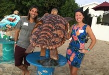 Chris and Sarah Lima show off the turtle he made and she wood-burned. (Source photo by Susan Ellis)