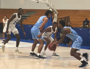 Tavion Pierson fights through a screen during UVI's loss on Friday Night Against Keiser University. (Source photo by Kyle Murphy)