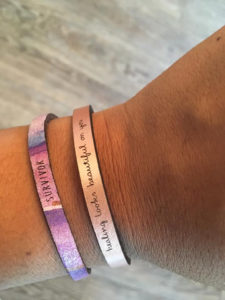 Two of the YAG Collection bracelets available for sale. ALl proceeds benefit the organization. (Source photo by Denise Lenhardt-Benoit)