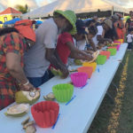 Contestants dig into the coconut jelly scoop competition during 2018's Crucian Coconut Festival. (Submitted photo)