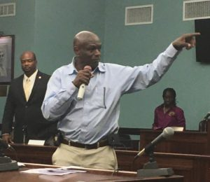 Carlton Dowe gestures to staff members while Sen. Steven Payne looks on at Monday's meeting. (Source photo by Amy Roberts)
