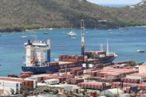 Cargo ship unloads containers. (Photo from Crowley Maritime website)