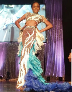 Second runner-up Tatyana Massiah models the high-fashion gown that won her that segment of the competition. (Source photo by Melody Rames)