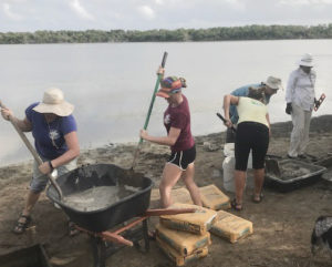 Volunteers mix concrete for the bird blind. (Contributed photo by Romina Ramos)