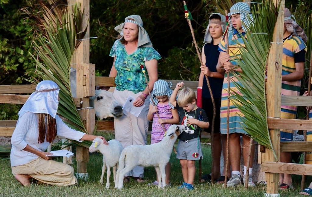 Jane Coles, Caitlin Kuczynski, Michael Kuczynski, Finn Miller, Joey Croney join in the live nativity. (Source photo by Linda Morland)