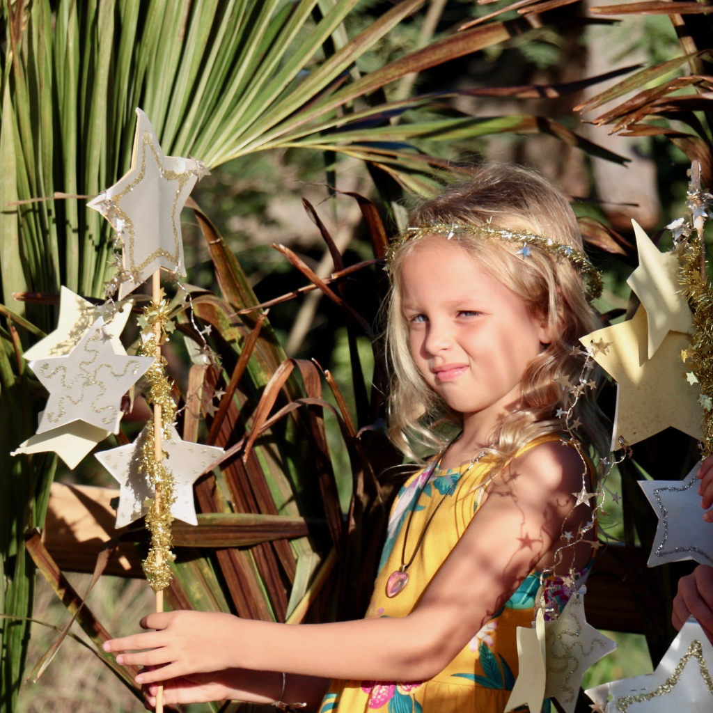 Nora Kammerzelt is a star among palm fronds and dappled sunlight. (Source photo by Linda Morland)