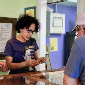 Nellie O'Reilly, one of the new owners of Sonya's Ltd., helps a customer choose a bracelet. (Source photo by Linda Morland)