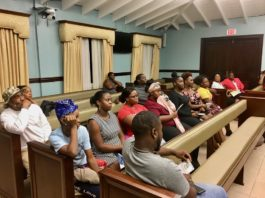 Young St. John residents listen while police officials outline the steps to become an officer. (Source photo by Amy Roberts)