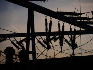 Electric power grid in silhouette. (Shutterstock image)