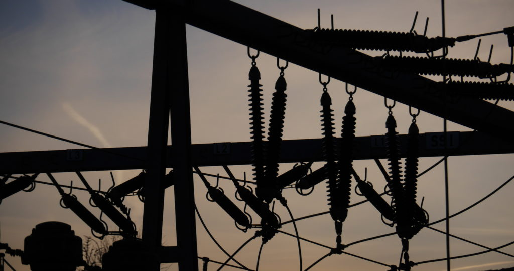 Electrical power grid in silhouette. (Shutterstock image)
