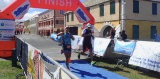 Catherine Sequin and Troy Holloway cross the finish line together. (Source photo by Susan Ellis)