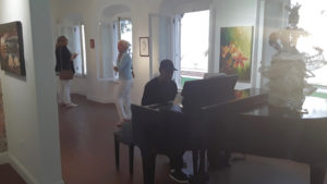 Upstairs Gallery with music and Bamboula Woman by Waldemar Brodhurst. (Source photo by Darshania Domingo)