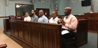 """Panelists at Wednesday's meeting on St. John, from left, DLCA Commissioner Richard Evangelista, Hemo board member Laurent """"Tippy"""" Alfred, DLCA Director of Consumer Affairs Miguel Tricoche, DLCA's Assistant Director of Environmental Health Juanita Johannes, and Director of the Division of Licensing Horace Graham. (Source photo by Amy Roberts)"""