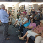 Rasmussen answers audience questions about his work dating objects discovered 100 years ago in the U.S. Virgin Islands. (Source photo by Don Buchanan)