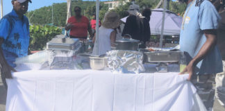Alvis Christian from Johns Folly Learning Institute and promoter Roy Reid maneuver a table into the serving station. (Source photo Judi Shimel)