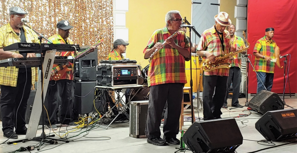 Stanley and the Ten Sleepless Knights – decked out in Madras – perform Saturday at the Madras Dance. (Source photo by Denise Lenhardt-Benoit)