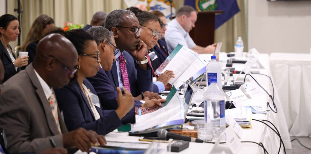 Officials from the USVI flank Gov. Albert Bryan at Tuesday's Inter-Virgin Islands Council meeting. (Government House photo)