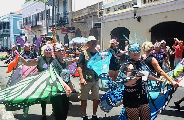"""""""Butterflies"""" journey through the streets, greeting the Carnival crowd. (File photo)"""