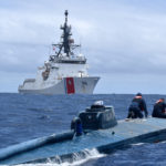 In a separate, similar incident at sea, U.S. Coast Guard Cutter Munro crew members inspect a self-propelled semi-submersible June 19, 2019, in international waters off Ecuador. The vessel was carrying more than 39,000 pounds of cocaine. Crew membes of a similar submersible were interdicted by the Cutters Hamilton and Resolution a month earlier and pleaded guilty in District Court on St. Thomas. (U.S. Coast Guard photo)