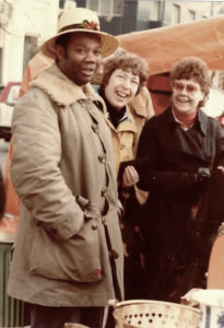 Eddie Donoghue poses with some patrons at an outdoor market in Sweden in 1970. (Photo provided by Edwin L. Martin)