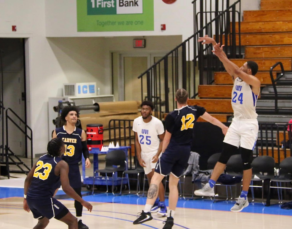 Keith Gilmore puts up a three-pointer over a Carver College defender. (Source photo by Kyle Murphy)