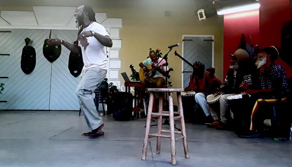 Iyaba Ibo Mandigo tells a story of growing up in the islands. (Source photo by Darshan Domingo)