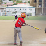 Jamali Allick Jr. takes a swing at a pitch. (Photo by Nour Suid)