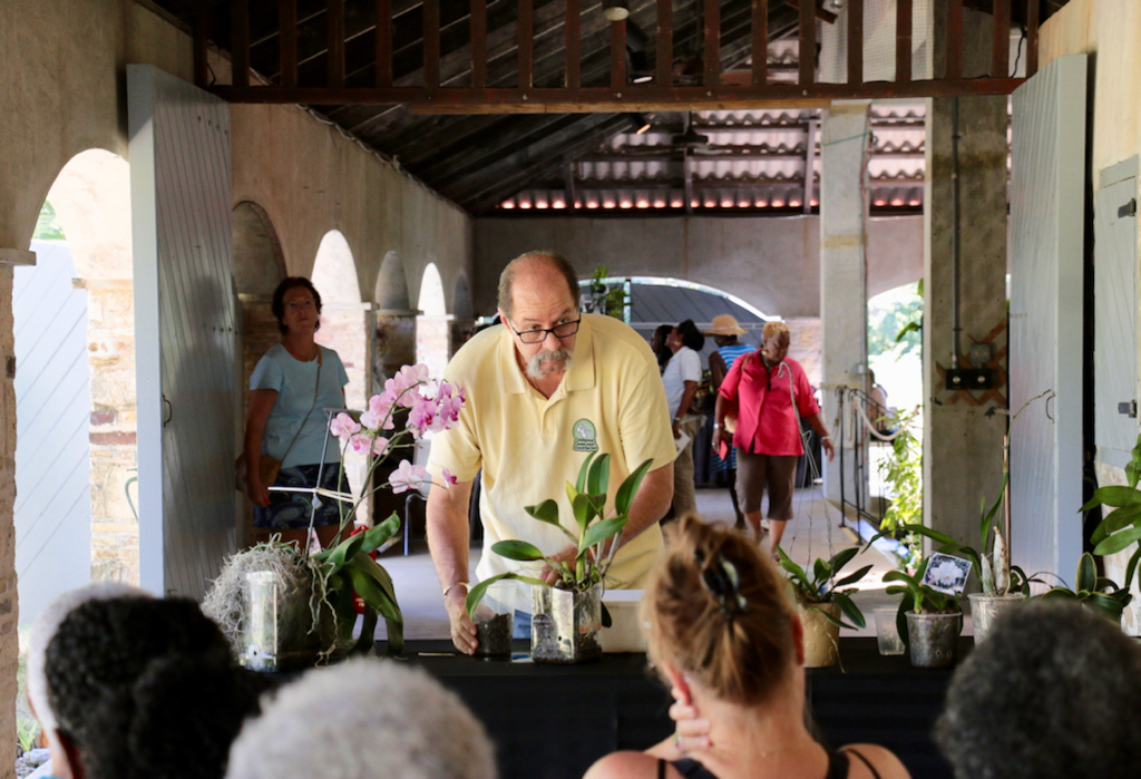 """Thomas Kash, a St. Croix Orchid Society member presents """"Growing Orchids Using Semi-Hydroponics"""" to an interested audience. This was one of five workshops offered during the three day show. (Source photo by Linda Morland)"""