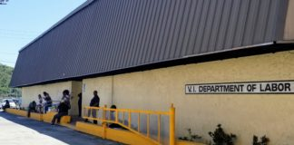 People wait outside the Department of Labor standing three to six feet apart from one another to maintain social distancing. (Source photo Bethaney Lee)