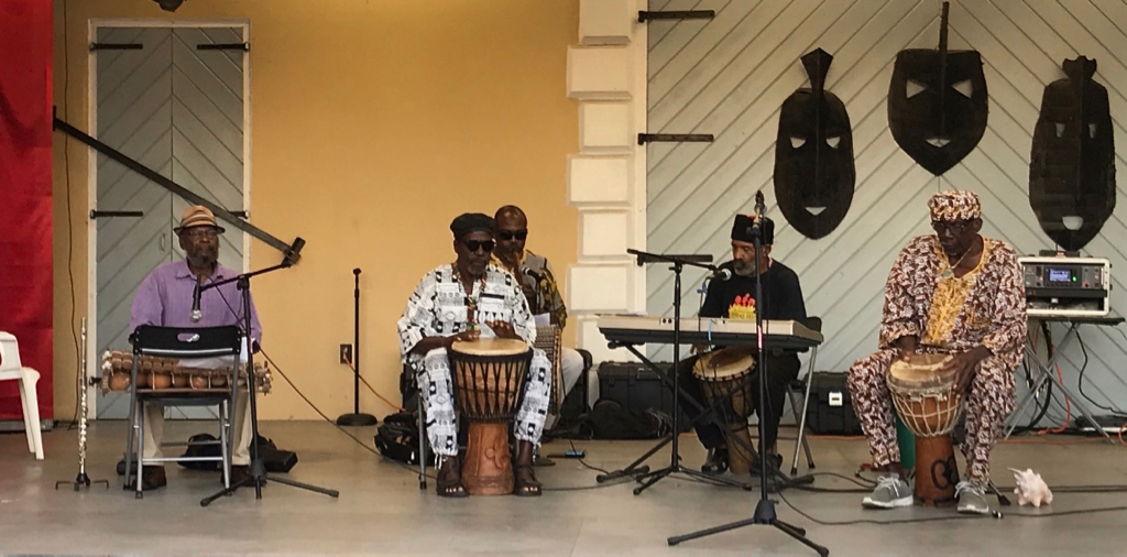 Ay Ay Rhythm Ensemble: from left, Sam Smith, drums/spoken word; Ezra 'Shammie' Thomas, drums; Sneferu Hotep,flute; Olu Massey, drums/spoken word; Junie Bomba,drums, are accompanied performers with African, Caribbean music and spoken word poetry. (Source photo by Elisa McKay)