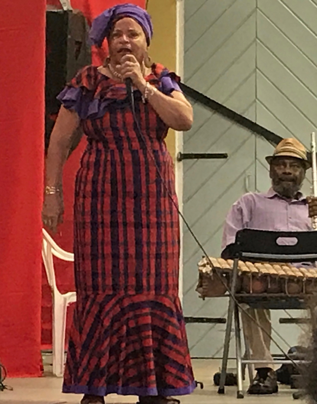 Cedelle Petersen Christopher, who learned Cariso from Leona Watson, performs 'Clear de Road' and 'Sly Mongoose.' Christopher is a retired educator who performs Cariso and storytelling and makes puppetry for school children. (Source photo by Elisa McKay)
