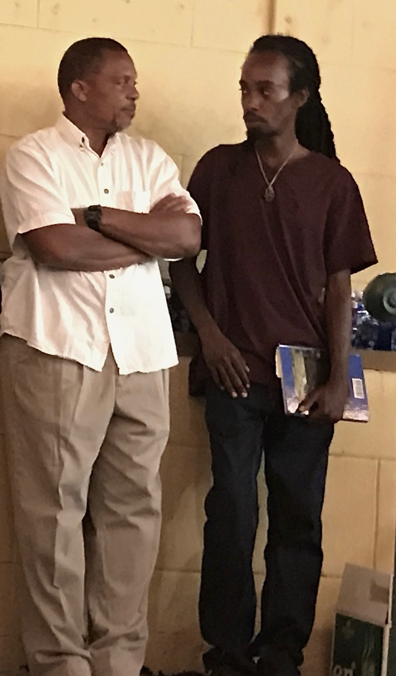 Jay Watson, left, the sSon of the late Leona Watson, performed Cariso in honor of his mother. He spoke with the crowd about growing up with the Virgin Islands culture bearer. He is joined by Geron Richards, poet and teacher. (Source photo by Elisa McKay)