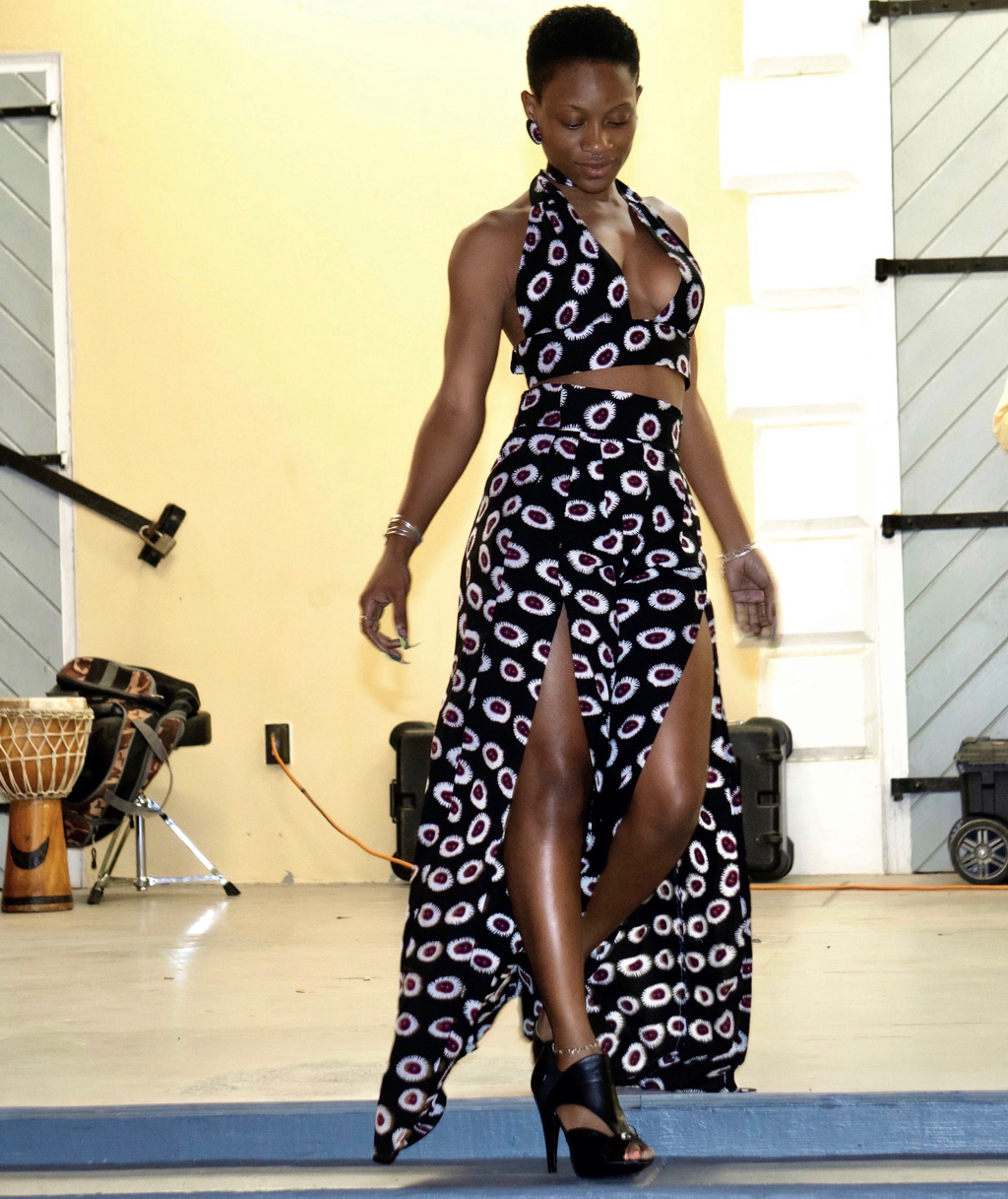 """Kezia """"Kizee"""" Sylvester of Royal Modeling Agency, managed by Christopher Rivera, models a floor length African print original by Giana """"Regal"""" Christopher, who is a self-taught seamstress, also works in madras, owns and operates Regal Fashions since 2012.. (Submitted photo)"""
