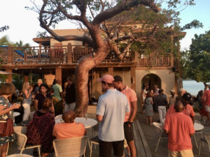 Guests mingle at Lovango Cay during a pre-opening tour in February. (Source photo by Amy H. Roberts)