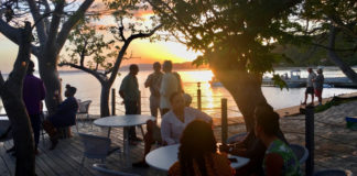 Guests enjoy the sunset from the deck at Lovango Cay. Source photo by Amy H. Roberts)