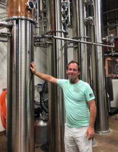 Todd Manley with kettles for making vodka at the Sion Farm Distillery. (Source photo by Susan Ellis)