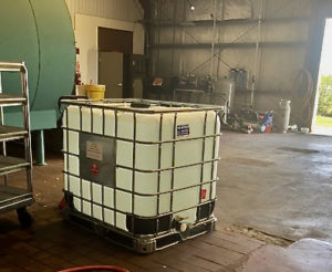 A 280 gallon container of breadfruit sanitizer. (Source photo by Susan Ellis)