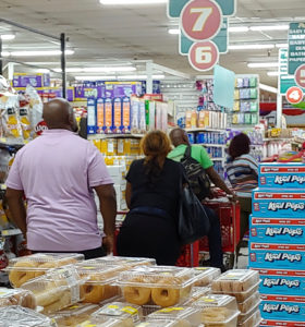 Customers wait in line at Pueblo Long Bay. (Source photo by S. Pennington)